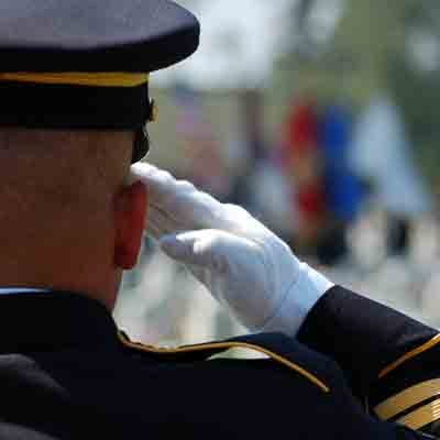 soldier in dress uniform saluting